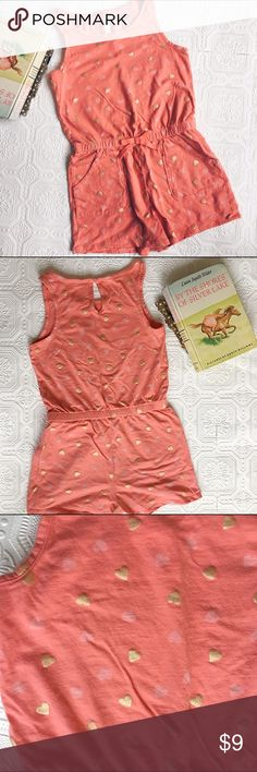 👫 Circo Coral Romper Very good used condition. Circo brand sleeveless cotton romper in coral with pale pink and gold metallic heart print. Elastic waistband and front pockets. Keyhole button closure in back. Only worn a few times. Size is M 7/8. Circo Bottoms Jumpsuits & Rompers