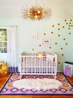 This gold dot wall and gold light fixture is gorgeous. Caden Lane's mint and gold dot baby bedding would be the perfect item to complete this baby nursery.