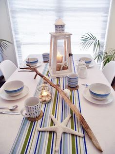 Nautical Table Setting - like the striped runner and lanterns