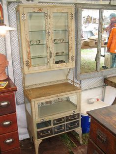 medical / dental cabinet  wonderful looking vintage medical/dental cabinet with beveled glass doors above, a glass door that opens down below and 6 drawers.