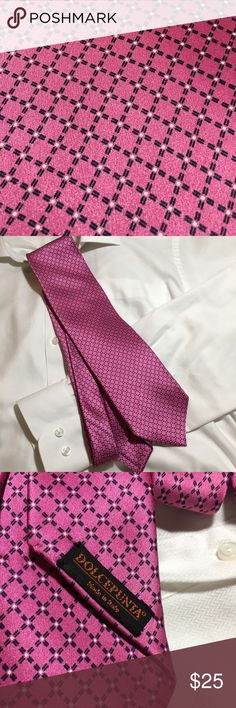 """Dolcepunta tie 100% silk pink dotted windowpane Dolcepunta 100% silk tie. Pink dotted windowpane pattern. Looks great with black or navy. Very heavy hand made in Italy crisp folds, flat seams in great condition. There is a magnetic tie tack impression in fabric, but no holes!  SPECS: Pink background Dotted windowpane pattern 61"""" long 4 3/4"""" widest 1 1/4"""" narrowest Dolcepunta Accessories Ties"""