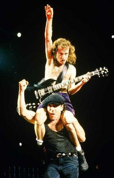 Photo of Brian Johnson and Angus Young sitting on Brian Johnson's shoulders performing live onstage Angus Young, Ac Dc Band, Ac Dc Rock, Heavy Rock, Rockn Roll, Rock Posters, Blues Rock, Music Love, 80s Music