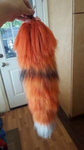 diy costume animal yarn tail for foxes, wolves, kitsune, cats, etc. I'm making these for our Halloween costumes!