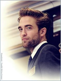 Robert Pattinson ringing the bell at the New York Stock Exchange as part of the Cosmpolis promo, 2012.