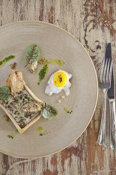 The food presentation matches the decor perfectly. Here, mushroom pâté en croûte.