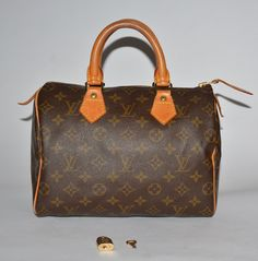 Authentic Louis Vuitton Monogram canvas Speedy 25 with the original lock and key.  At low price at my site:  grantaboutique.com  More gently used designer brand bags and accessories at a low price.