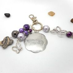 A parfumer!!! bijou de sac papillon perles violettes