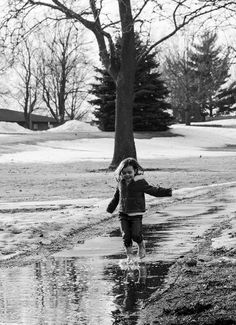puddles. child photography.