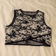 NWOT MINKPINK Patterned Crop Top NWOT Black and white patterned Scuba-esque crop top. Thick material but super comfortable and easy to dress up or down. MINKPINK Tops