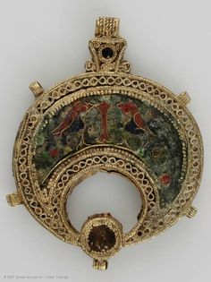 Part of a necklace in the form of a crescent  11th-12th century  Egypt  Gold with granulation, gold filigree and cloisonné enamel decoration