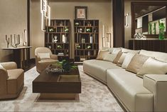 """The """"Symphony in Beige"""" living and dining room by Oasis features a Dahlia sofa, Yves small tables, two big Magritte bookshelves, perfect for book of any size, and a Saint-Germain console. The light is provided with Edge lamps, suspension, floor and wall versions."""