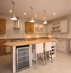 Beautiful, handmade in wales kitchen with build in wine rack and wine fridge in the island unit