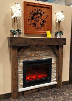 FPX Electric Fireplace, Custom Built Knotty Alder Beam Surround, Natural Ledgestone Veneer Panels, Limestone Hearth, Welded Steel Banding with Rivets