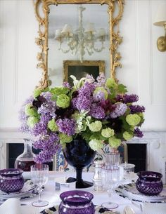 Purple and Green floral in a dark blue vase...lovely.