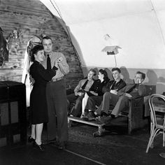 Life in the Aleutians, WWII: military personnel and Nurses relaxing (Notice the nurses in their off-duty dresses)