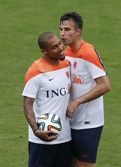 World Cup 2014: Pictures Of The Day Wednesday 11th June 2014 - Robin van Persie, right, and Nigel de Jong, left, of the Netherlands share a light moment during a training session in Rio de Janeiro, Brazil, Tuesday, June 10, 2014. The Netherlands play in group B of the 2014 soccer World Cup.