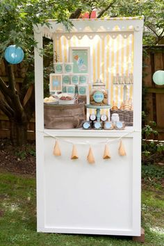 I would love to have a stand like this to set up for the food at outdoor parties in the backyard! Imagine the possibilities- you could change out the fabric for a totally different look! Adorable!