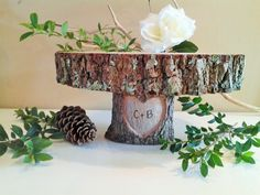 """Beautiful Natural oak tree trunk cake stand with heart engraved base ... Personalized woodburning , Perfect for any special event or wedding .. Sizes available from 10"""" - 18"""" cake stands."""