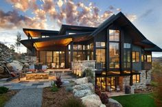 This two-story contemporary mountain home was designed in 2016 by Vertical Arts Architecture, located in Steamboat Springs, Colorado. architecture, Breathtaking contemporary mountain home in Steamboat Springs Dream Home Design, Modern House Design, Modern House Plans, Design Exterior, Exterior Paint, Modern Exterior, Door Design, Garage Design, Exterior Colors