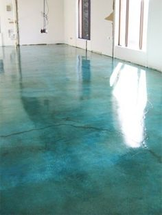 Beautiful Aqua stained concrete floor! http://tablemountaincreativeconcrete.com/commercial-concrete/