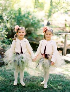 Adorable flower girls in their tulle tutus keeping warm in little white sweaters. And sweet little single flower headbands.#tutu #flowergirls