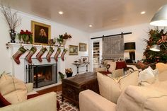 This country Christmas living room uses a foundation of neutrals accented by checks, plaids and stripes as well as assorted equestrian-themed decor.
