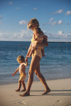 Family Goals: Barefoot Blonde Amber Fillerup wearing matching Marysia Swimsuits
