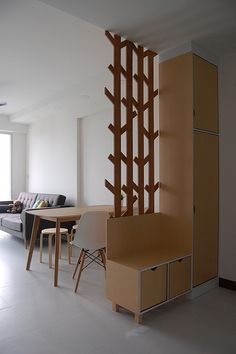 Wooden room divider with cabinet/bench