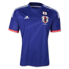 The Japan 2014 World Cup home jersey is in the team's traditional blue with a rounded neck design. It features peach colored sleeve cuffs along with a peach and white band across its back in a painted on effect.