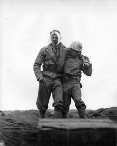 US Marine leads a comrade wounded in the head in a mortar attack on Iwo Jima.