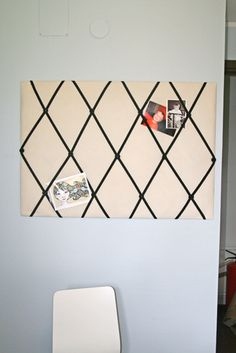 Picture Board DIY-This blog says to use cardboard and cover it with fabric (I think you could skip a step by picking up a cheap canvas board from Walmart, but that also makes it a heavier object to hang on the wall.