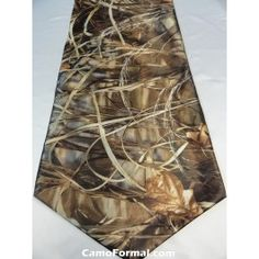 """Everywhere there's a wedding, there is a groom.Where there's a wedding, there is a reception and a groom's cake.Where there's a club, there's a banquet.Where there's a need or a cause, there's a fund-raiser.Camouflage table linen will make an impression.This 12"""" x 57"""" table runner is perfect for decorating any groom's table.Available in all camo prints.Made in the USA."""