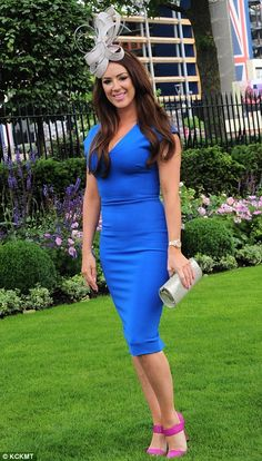 Smart: A lady in a cobalt blue shift dress and bright pink heels