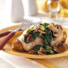 Spinach and Mushroom Smothered Chicken Recipe Main Dishes with baby spinach, fresh mushrooms, green onions, chopped pecans, olive oil, boneless skinless chicken breast halves, seasoning, reduced fat provolone cheese
