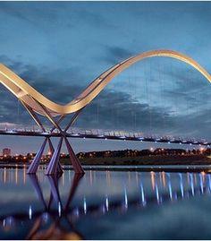 The Infinity Bridge is a public pedestrian and cycle footbridge across the River Tees in the borough of Stockton-on-Tees in the north-east of England. Melbourne Australia, Australia Travel, Palaces, Love Bridge, Stockton On Tees, Photo Portrait, Bridge Design, Pedestrian Bridge, Civil Engineering