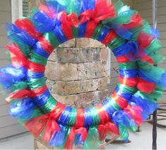 Organza Holiday Wreath with Christmas Light Garland in Red, Blue, and Green - pinned by pin4etsy.com