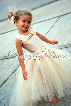 Custom Made Champagne Flowergirl Dress. Corset top, tutu skirt with train and hair clip. Size 12m-5T. Custom sizes and colors available. $85.00, via Etsy.
