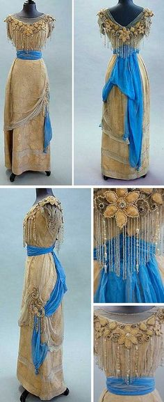 ~Evening gown, ca. 1910-14~   Gold damask with blue chiffon sash and gold florets. Bodice has beaded fringe. Kerry Taylor Auctions