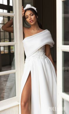 One shoulder fold over ball gown wedding dress with high slit for the glamorous romantic bride. Pollardi Wedding Dresses 2021 Royalty Collection - Belle The Magazine #weddingdress #weddingdresses #bridalgown #bridal #bridalgowns #weddinggown #bridetobe #weddings #bride #dreamdress #bridalcollection #bridaldress #dress See more gorgeous bridal gowns by clicking on the photo