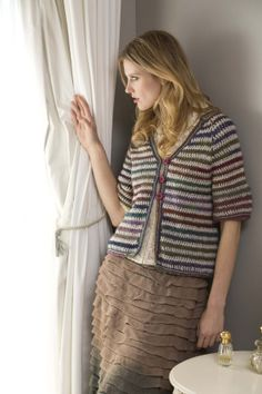 The self-striping Amazing® yarn combined with the solid color of Fishermen's Wool® gives this striped jacket a colorful and unique look.