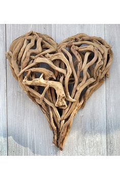 Driftwood Heart 16 This charming hand-crafted driftwood heart will add dimension and texture to your walls. It can be hung indoors or outside, and measures approximately x Sturdy hook on back for easy hanging. Allow 2 weeks for delivery Driftwood Beach, Driftwood Art, Beach Wood, Driftwood Mobile, Driftwood Furniture, Beach Art, Beach Chic Decor, Sugarboo Designs, Driftwood Projects