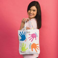 How adorable would this be to do for a teacher??? Get home room moms to help, get each kid's handprint in the class, write the year, and you have a perfect end of the year thank you gift for your child's teacher! :)