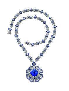 A SAPPHIRE AND DIAMOND SAUTOIR, BY BVLGARI  Suspending a detachable pavé-set diamond octagonal pendant, set with a sugarloaf cabochon sapphire, weighing approximately 52.72 carats, with calibré-cut sapphire trim and bullet-cut diamond accents, to the pavé-set diamond neckchain, spaced by calibré-cut sapphire geometric links, mounted in platinum, 1969, 29¾ ins., pendant may be worn as a brooch Pendant and neckchain signed BVLGARI $5,906,500.00