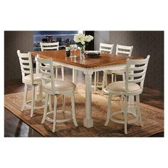 7 pc wilton two tone distressed oak and antique cream finish wood counter height dining table set. This set includes the table and 6 swivel chairs . Table measures x x H. Side chairs measure H to the back . Additional chairs also availabl