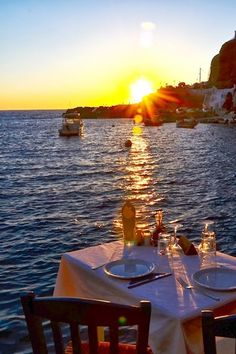Romantic sunset in Ammoudi port, Santorini , Greece