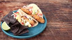Fried catfish, barbecue sauce, and tacos? Count us in! Simplify the process by using a premade fish fry mix, coleslaw mix, and bottled BBQ sauce. Just top with fresh produce, and you've got a quick and filling weeknight favorite!See more: Classic Fried Catfish