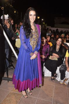 Neha Dhupia chose a purple anarkali dress to attend an event
