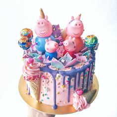 12 Cute Peppa Pig Birthday Cake Designs A Peppa Pig themed cake with rainbow coloured frosting, lollipops and figurines. Corine and Cake.Source Best Picture For Cake Design for women For You Tortas Peppa Pig, Bolo Da Peppa Pig, Peppa Pig Birthday Cake, Birthday Cake Girls, Peppa Pig Cakes, Princess Peppa Pig Party, Girls 2nd Birthday Cake, Pig Candy, Pig Cupcakes