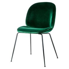 <p>Designed in 2013 and first presented at Milan's annual Mindcraft exhibition, the Beetle Dining Chair is the creation of young design duo, Enrico Fratesi and Stine Gam, and is inspired by the shape, shell and structure of the eponymous insect.</p>