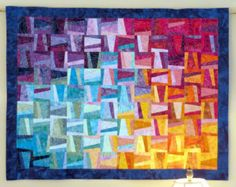Handcrafted Quilted Batik Wall Hanging Fractal Sun Rise.  Batik in quiltsbysuewaldr.   $250.   Fractal - should go in math!